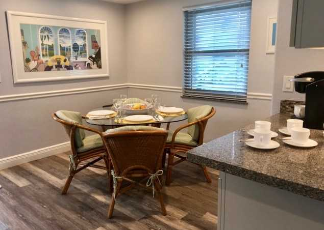 Dining open to kitchen and living space