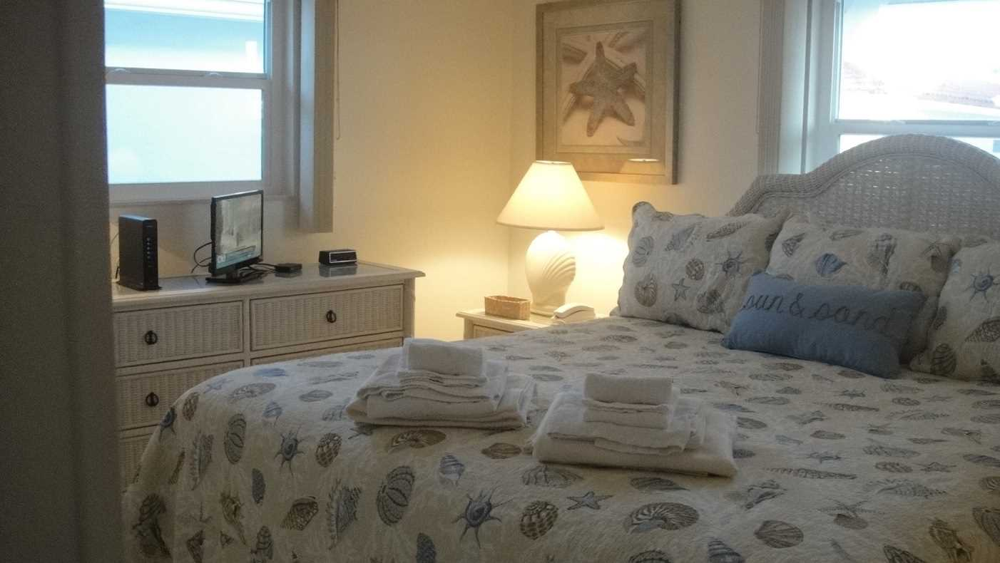 Master bedroom with king bed and flat screen